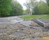 Damage to Valley Parkway in the Cleveland Metroparks Mill Stream Run Reservation as a result of the May 12, 2014 flood.